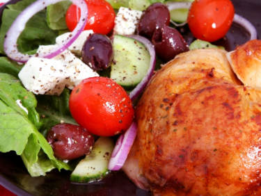 greek salad and roast chicken, may not be exactly as shown
